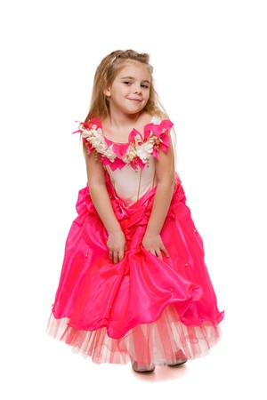 curtsy: Fetching 6 years old girl in pink princess dress , over white background Stock Photo