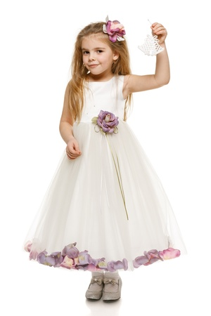6 years girl: Adorable 6 years old girl in princess dress holding bells, over white background