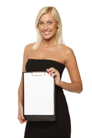 Smiling woman standing holding a white blank billboard   placard, over white background Stock Photo - 17537610