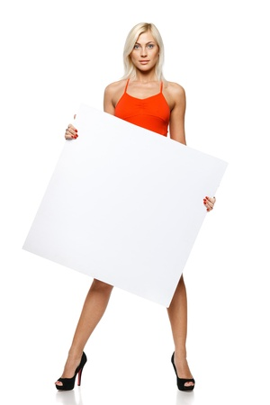 Calm woman in full length holding empty banner, over white background photo