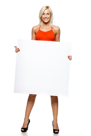 Woman in full length holding empty banner, over white background photo