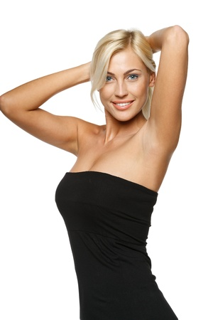 strapless dress: Joyful relaxed woman standing with hands over head, over white background