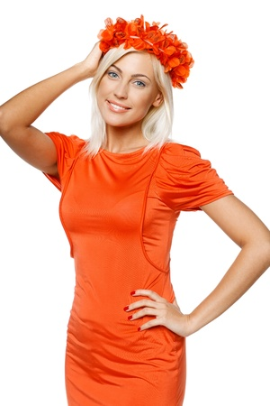 Smiling woman in bright orange dress holding the orange wreath on her head, over white background Stock Photo - 17537629