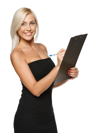 Smiling woman making notes on the tablet, over white background photo