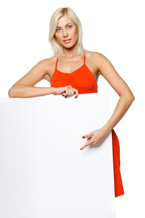Woman standing leaning at empty whiteboard, pointing at it, over white background Stock Photo - 17537549