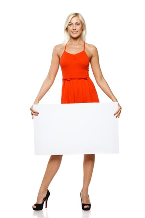 Woman in full length holding empty banner, over white background Stock Photo - 17537469