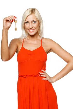 Bright picture of pretty young lady holding keys isolated on white background photo