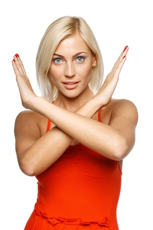 rejected: Young woman making stop gesture over white background