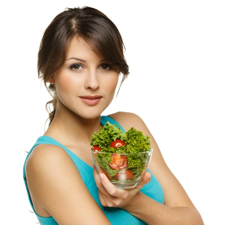 Beautiful woman holding transparent bowl with healthy salad meal, over white Stock Photo - 17537540