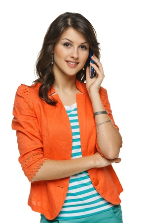 Bright picture of young woman talking on cellphone, over white background photo