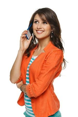 pants: Bright picture of young woman talking on cellphone, looking up, over white background