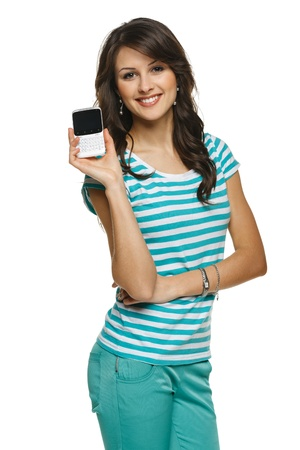 Young woman showing her mobile phone, over white background