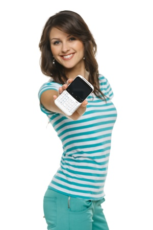 Young woman showing her mobile phone, shallow depth of field, focus on the phone, over white background