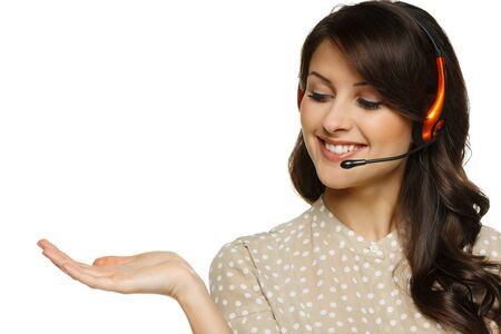 service center: Smiling cheerful woman in headset holding empty copy space on her open palm, looking at palm, isolated on white background