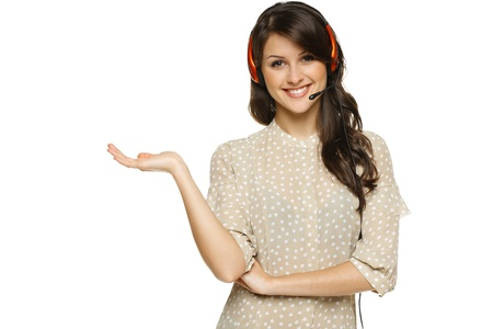 operators: Smiling cheerful woman in headset holding empty copy space on her open palm, looking at camera, isolated on white background