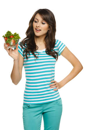 astonished: Woman holding healthy salad meal, over white Stock Photo