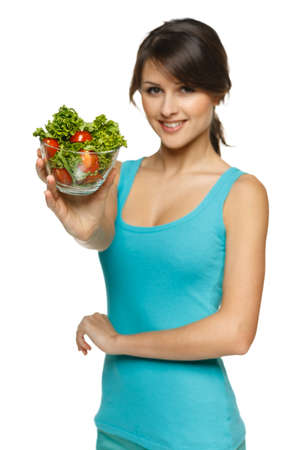 Smiling woman offering you a bowl with salad, shallow depth of field, focus on the salad, over white Stock Photo - 17537530
