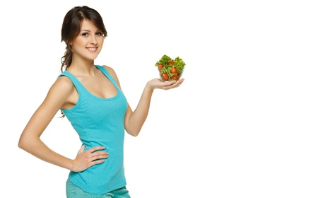 Beautiful woman holding transparent bowl with healthy salad meal, over white, with copy space Stock Photo - 17537552