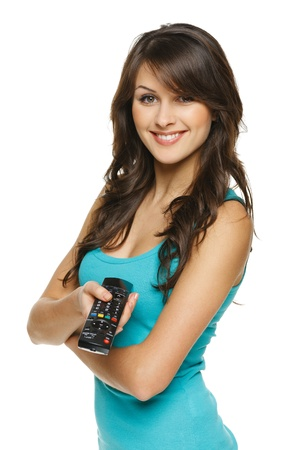 video cables: Happy woman holding TV remote control, over white background