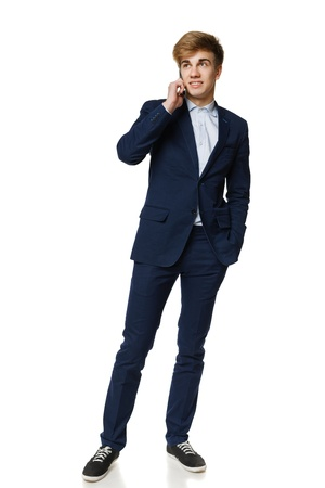 fmale: Full length of young business man talking on cellphone, over white background Stock Photo
