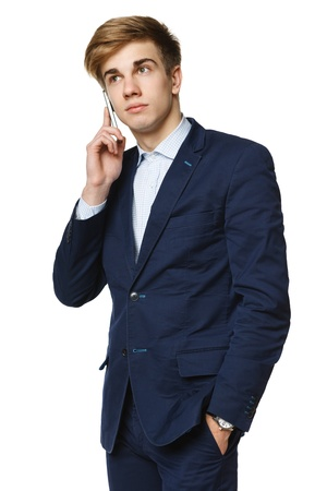 fmale: Young trendy man talking on cellphone, over white background