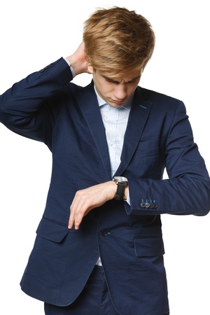 corporate waste: Worried business man looking at watch