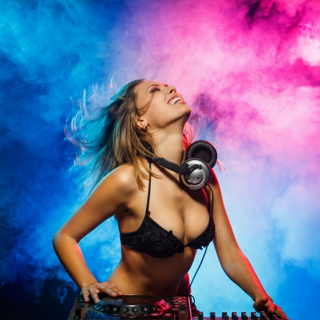 sexy woman disco: Excited DJ girl on decks on the party Stock Photo