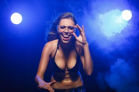 sexy headphones: Excited DJ girl on decks on the party Stock Photo