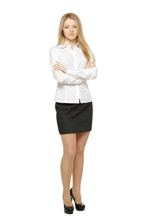 Full length of young female standing with folded hands, isolated on white background photo