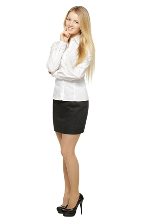 businesswoman skirt: Full length of young smiling female standing with folded hands, isolated on white background