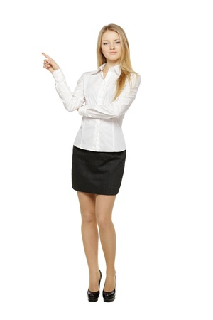 Full length of beautiful blond business woman pointing at copy space over white background photo