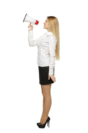 agitation: Side view full length of young business woman with megaphone, over white background