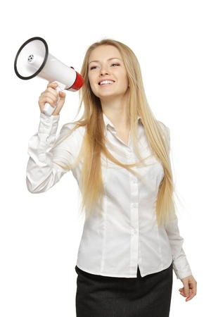 Young business woman with megaphone, over white background photo