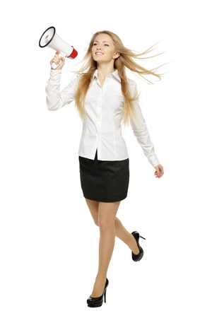 Young business woman running with megaphone, over white background photo