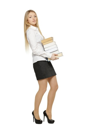 Full length of astonished female holding stack of books, over white background photo