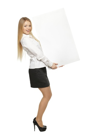 Full length of young female holding the blank board isolated on white background photo
