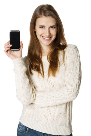 Happy young woman showing her mobile phone over white background Stock Photo