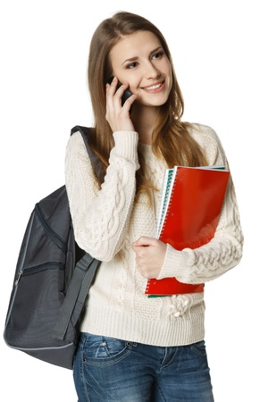 calling communication: Happy woman university student with backpack and books talking on cell phone, looking out of frame, isolated on white background