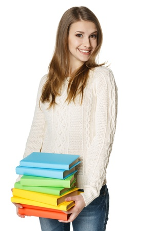 Playful female carrying a heap of books, over white  background photo