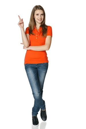 Woman pointing up standing in full length, isolated on white  photo