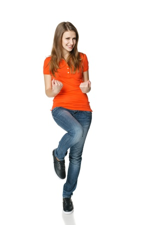 victorious: Full legnth of successful young female teenager in casual showing yes, isolated on white background
