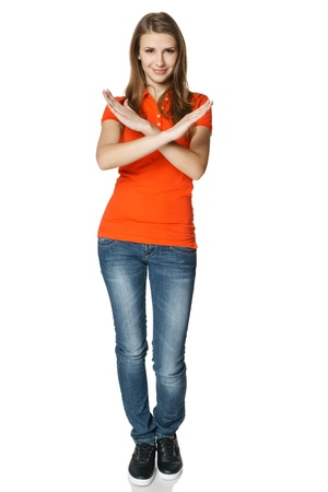 Smiling young woman in full length making stop gesture Stock Photo - 18162674