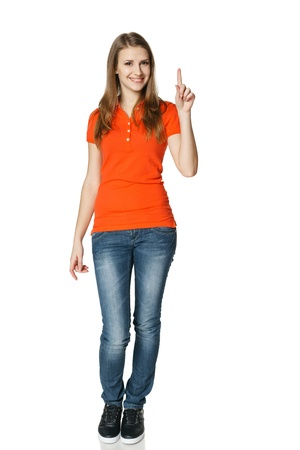 Woman pointing up standing in full length, isolated on white