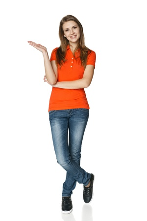 Full length of young  casual woman showing empty copy space, over white background