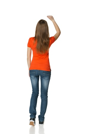 copy writing: Back view of young casual female in full length writing on the blank copy space, isolated on white