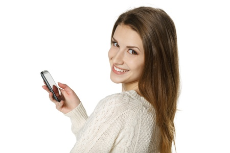 sweater girl: Closeup of young  happy woman with mobile phone, over white background