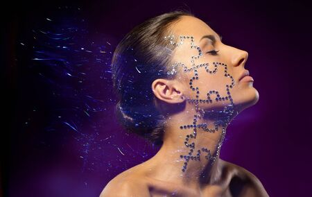 Fashion art portrait of female with beauty crystal puzzle on her face photo