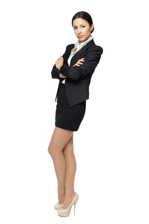 cross armed: Business woman standing in full length with folded hands, isolated on white