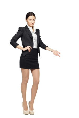 welcoming: Full length of beautiful business woman showing copy space over white background Stock Photo