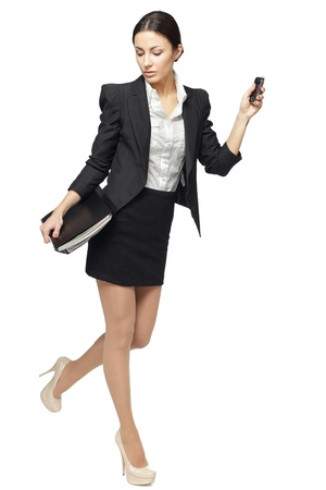 to rush: Full length of businesswoman hurring, isolated on white background Stock Photo